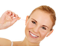 Young happy woman cleans her ear Stock Photography
