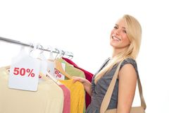 Young happy woman in clothes store Royalty Free Stock Photography