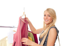 Young happy woman in clothes store. On a white background Stock Photos