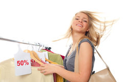 Young happy woman in clothes store. On a white background Royalty Free Stock Photo