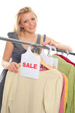 Young happy woman in clothes store. On a white background Royalty Free Stock Images