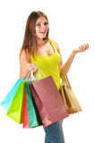 Young happy woman with colorful paper shopping bags isolated Stock Image