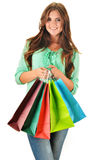 Young happy woman with colorful paper shopping bags Stock Photography