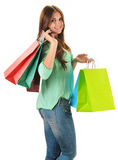 Young happy woman with colorful paper shopping bags Royalty Free Stock Images