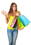 Young happy woman with colorful paper shopping bags Royalty Free Stock Image