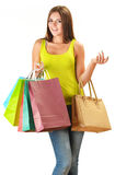 Young happy woman with colorful paper shopping bags Royalty Free Stock Photos