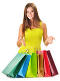 Young happy woman with colorful paper shopping bags Stock Photo