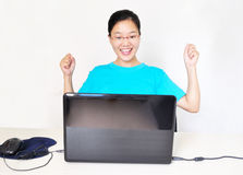 Young happy woman at the computer Royalty Free Stock Photo