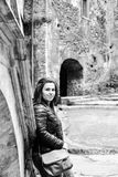 Young happy woman  at  Corvin Castle, Romania. Young happy woman at A Gothic-Renaissance castle in Hunedoara Transylvania, Castle in Hunedoara, Romania Royalty Free Stock Photography