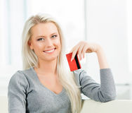 Young and happy woman with a credit card. Online shopping concept Stock Photo