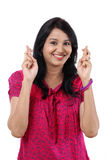 Young happy woman crossing fingers Royalty Free Stock Photos