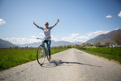 Young happy woman cycling in nature Royalty Free Stock Photos