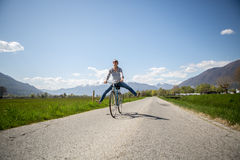 Young happy woman cycling in nature Royalty Free Stock Photo
