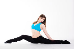Young happy woman does fitness exercise Stock Photo