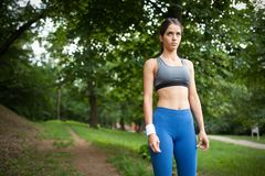 Happy young woman doing excercise outdoor in a park, jogging stock images