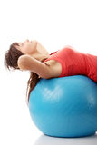 Young happy woman doing fitness exercise Stock Images