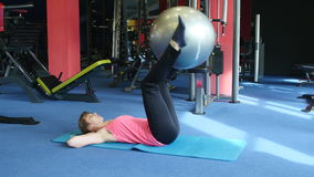 Young happy woman doing fitness exercise with fitness-ball, Gym.  stock video