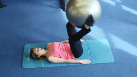 Young happy woman doing fitness exercise with fitness-ball, Gym.  stock video footage