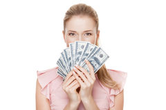 Young happy woman with dollars in hand. Isolated. Royalty Free Stock Images