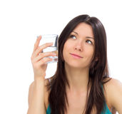 Young happy woman drink glass of drinking water and looking at t Stock Photos