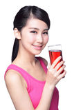 Young happy woman drink juice Royalty Free Stock Image