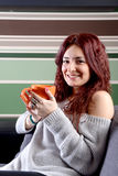 Young happy woman drinking coffee Royalty Free Stock Photos