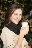 Young Happy Woman drinking coffee or tea Stock Image