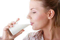 Young happy woman drinking milk Royalty Free Stock Photos