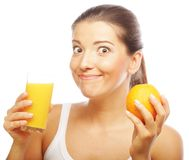 Young happy woman drinking orange juice. Royalty Free Stock Images