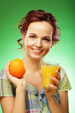 Young happy woman drinking orange juice. Royalty Free Stock Photo