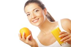 Young happy woman drinking orange juice. Stock Photos