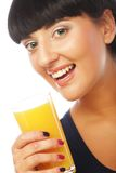 Young happy woman drinking orange juice Stock Photography
