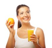 Young happy woman drinking orange juice Stock Photo