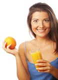 Young happy woman drinking orange juice Royalty Free Stock Image