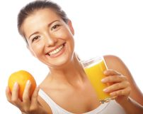 Young happy woman drinking orange juice Stock Images