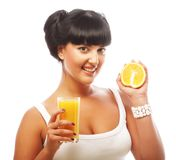 Young happy woman drinking orange juice Royalty Free Stock Photo