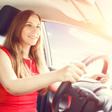 Young happy woman driving a new or rented car Stock Image