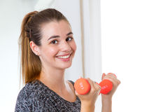 Young, happy woman with dumbbells Royalty Free Stock Photo