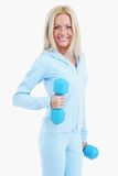 Young happy woman with dumbells Stock Photo