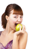 Young happy woman eating an apple. On white background stock images
