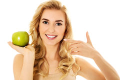 Young happy woman eating fresh green apple.  Stock Image