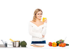 Young and happy woman eating a fresh paprika Stock Image