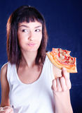 Young happy woman eating pizza Stock Images