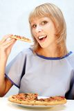 Young happy woman eating pizza Royalty Free Stock Image