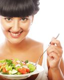 Young happy woman eating salad. Royalty Free Stock Photo
