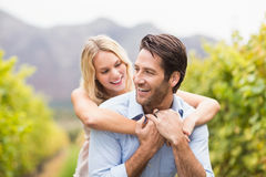 Young happy woman embracing young handsome man Royalty Free Stock Photography