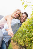 Young happy woman embracing young handsome man Royalty Free Stock Images