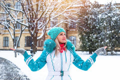 Young happy woman enjoy snow in winter city park outdoor Royalty Free Stock Images