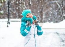 Young happy woman enjoy snow in winter city park outdoor Stock Photos