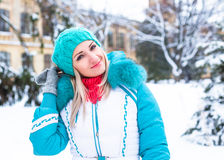 Young happy woman enjoy snow in winter city park outdoor Royalty Free Stock Photos